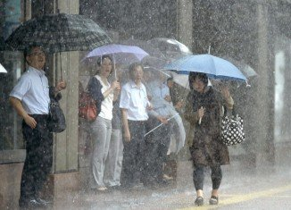Typhoon Neoguri was due to pass over Okinawa's main island later on Tuesday, with strong winds and torrential rain