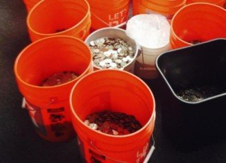 Adriana's Insurance Services settled a lawsuit with 17 buckets of coins, said to contain $20,000