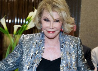 Joan Rivers was rushed to the hospital after she stopped breathing while undergoing a procedure on her vocal chords