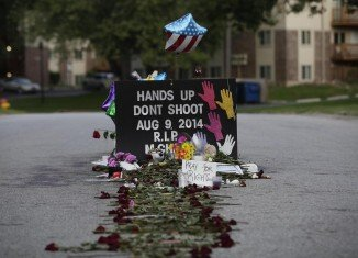 Michael Brown was killed on August 9 after being stopped by a white police officer for walking in the middle of the street