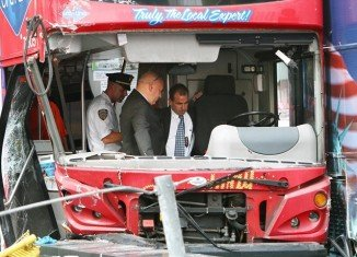 One of the two drivers involved in the double-decker tour bus crash in Times Square was arrested and charged with DWAI