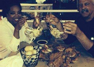Oprah Winfrey enjoying a seafood dinner with her longtime partner Stedman Graham at Captain James Landing in Baltimore