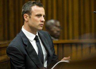 Oscar Pistorius denies prosecution claims that he deliberately shot Reeva Steenkamp