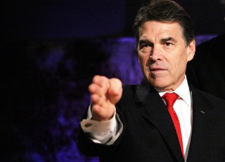 Rick Perry plans to turn himself in to authorities for fingerprinting and a mug shot