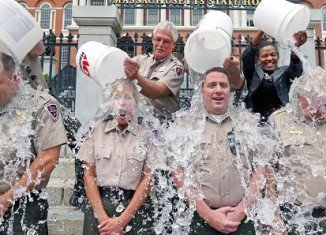 The ALS Ice Bucket Challenge is an activity involving pouring a bucket of ice water on someone's head or donating to the ALS Association