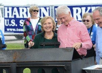 Hillary and Bill Clinton were to headline Senator Tom Harkin's annual steak fry fundraiser in rural Indianola