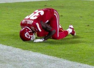 Husain Abdullah has been penalized after celebrating a touchdown by dropping to his knees in prayer