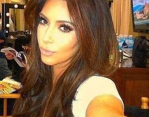Kim Kardashian was apparently jostled by someone waiting in a large crowd outside her car at a Paris Fashion Week event on September 25