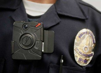 Police officers in Ferguson are now wearing body cameras after weeks of unrest over Michael Brown's killing