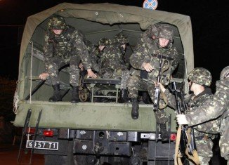 Seven Ukrainian troops are said to have died in a clash with pro-Russian rebels near Donetsk airport