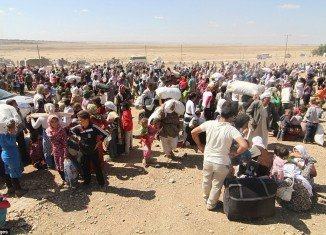 Some 45,000 mainly Syrian Kurds have crossed into Turkey in the past 24 hours as ISIS militants advance in northern Syria