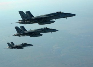 US-led airstrikes have destroyed four ISIS-held oil tanks and damaged another during a fourth night of bombardments in Syria