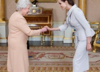 Angelina Jolie was presented with the insignia of an Honorary Dame Grand Cross of the Most Distinguished Order of St Michael and St George during a private audience at Buckingham Palace