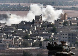 At least 553 people are said to have died in a month of fighting for Kobane