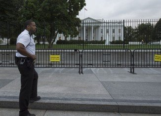 Dominic Adesanya was attacked by dogs after jumping the White House fence