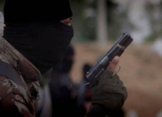 FBI officials believe the masked man in ISIS video betrays a North American accent as he speaks English and Arabic