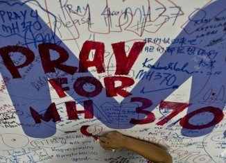 Flight MH370, from Kuala Lumpur to Beijing, disappeared with 239 people on board