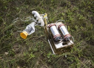 One of the 298 people killed in the downing of Malaysia Airlines flight MH17 over eastern Ukraine was found wearing an oxygen mask