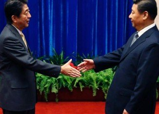 Japanese PM Shinzo Abe and Chinese President Xi Jinping have met for formal talks after more than two years of severe tension over a territorial dispute
