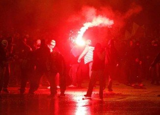 Polish police have used water cannon to disperse hundreds of masked men during march marking National Independence Day in Warsaw