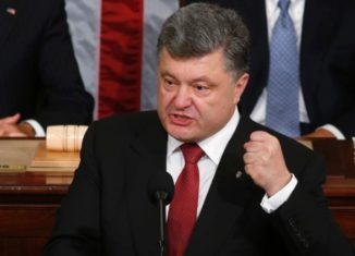 President Petro Poroshenko will chair a crisis meeting of security chiefs after rebel-held vote jeopardized the entire peace process