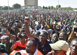Thousands of protesters gathered in Burkina Faso's capital Ouagadougou, demonstrating against the army
