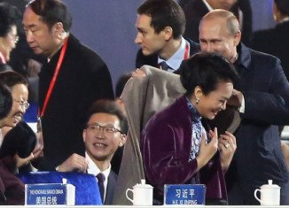 Vladimir Putin carefully placed a shawl over the shoulders of China's stylish first lady Peng Liyuan